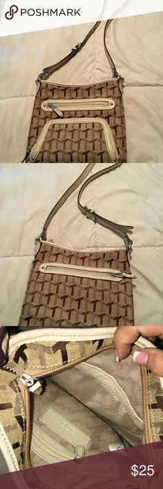 Tignanello  designer  crossbody  purse Tignanello  crossbody, multiple  tones of brown ,no flaws.  Like new.  Changing  my style. Tignanello  Bags Crossbody Bags