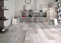 Los pavimentos y revestimientos 'Woodstyle' son un trampantojo. No son de madera, son porcelánicos y sirven tanto para la solería como para revestir la pared.