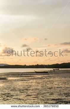 After sunset with low tide at Cape Yamu bay, Phuket, Thailand - stock photo