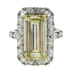 GIA 4.41 Carat Emerald Cut Fancy Light Yellow Diamond Gold Platinum Halo Ring   From a unique collection of vintage wedding rings at https://www.1stdibs.com/jewelry/rings/wedding-rings/