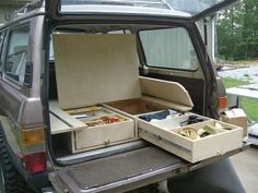 Minivan with DIY sleeping platform and drawer system. My weekend of event with rain has just got better!!!