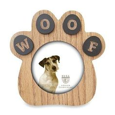 "Put your pooch in a place of honor with the Paw Sentiment Frame in Natural Wood. The adorable paw shaped frame features a laser cut ""woof"" detail and displays a 4"" x 4"" photo of your canine best friend."