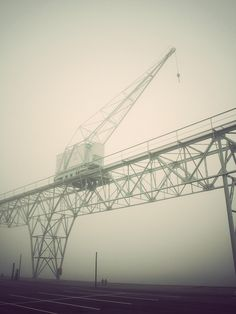 Beautiful atmospheric architectural photograph of a large steel crane and bridge construction, photographed by Kim Holtermand