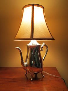 Really interesting lamp... http://www.etsy.com/listing/77536658/a-silver-tea-pot