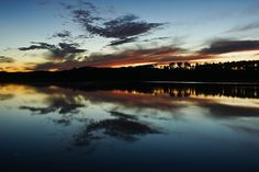 Bob Hill Lake, Riding Mountain National Park, Manitoba, Canada. Photo by Warren Justice. #sunsets #Canada #travel