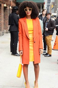 Solange Knowles stunning in bright tangerine orange and canary yellow