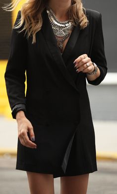 Helena Glazer is wearing a tuxedo dress from Lovers & Friends and a statement necklace