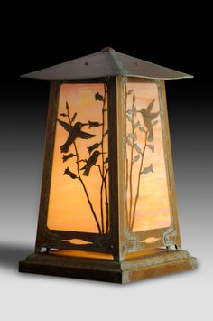 Everyone loves hummingbirds. This solid brass Pedestal Lamp can also be converted to a column mount lantern that is perfect for the craftsman garden or front entry.