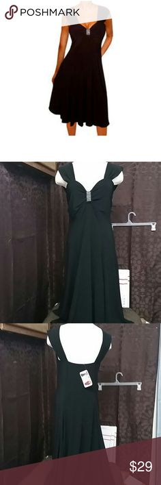 NWT funfash dress size 16 Sexy black dress adorable gyms in between the breast size 16 this is new with tags 92% polyester 8% spandex armpit to armpit laying flat 18 inches length for shoulder down 43 inches funfash Dresses