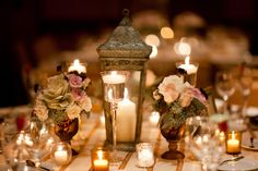 lantern  centre piece with tea lights and single flower heads x