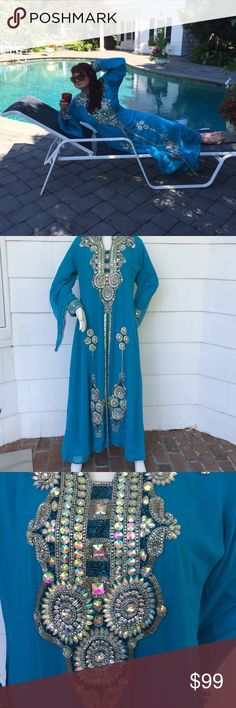 """Dubai Arabian Goddess Gown Beautiful turquoise hand bejeweled Arabic gown.  Purchased in deserts of Dubai after a camel ride.  Measures 57"""" from neckline to bottom edge of gown. Size L   100% polyester. Dresses Long Sleeve"""