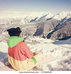 Image of achieve female snowboarder on the background of high snow-capped Alps, Swiss. Healthy lifestyle. Achievement