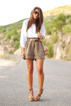 Khaki Chic #streetstyle  I absolutely love this outfit! So simple to achieve yet gives off a classy vibe! The heels paired with the shorts just tops off the look!