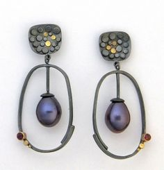 Idea for using lots of rivets of different metals - this is a small earring by Sydney Lynch
