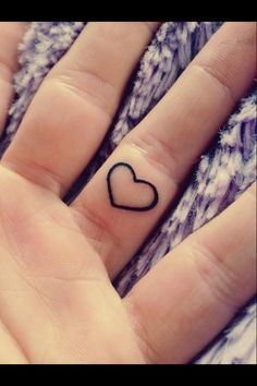 My new tattoo. It's on my left hand, inside of the ring finger. One day my wedding ring will lie over my heart. And if someone is holding my left hand they have my heart in their hand.