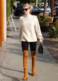 These boots were made for walking: Emma Roberts gave her petite 5ft2in stature a big boost with brown suede over-the-knee boots while strutting through West Hollywood on Tuesday