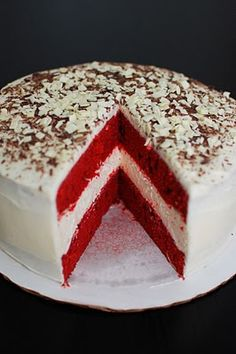 Red velvet cake with a layer of cheesecake in between and shaved chocolate as decoration