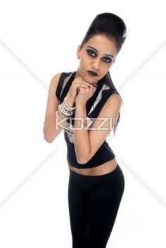 indian fashionable woman with hands clasped. - Indian fashionable woman with hands clasped looking at camera over white background, Model: Kiran Bahugun