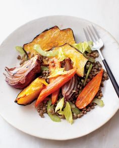 Roasted Fall Vegetables with Lentils has been a favorite of ours this winter.  Comfort food filled with flavor, and its really easy.  Slice some veggies, put them in the oven, put some lentils in a pot....wait about 25 minutes, and dinner is ready!