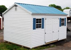 B-HMP2-1220-099 custom 12x20 vinyl sided shed with metal roog