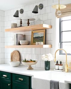 Modern farmhouse kitchen with chunky floating shelves and white tile backsplash. Farmhouse Kitchen Floating Shelves and white backsplash tile Studio McGee. Studio Kitchen, Home Decor Kitchen, New Kitchen, Kitchen Lamps, Design Kitchen, Kitchen Interior, Kitchen Ideas, Green Kitchen Cabinets, Kitchen Shelves