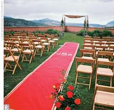 Ceremony Décor- let a hand-painted monogram runner lead you down the aisle.  Ceremony Site: The Peaks Resort & Spa