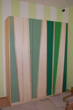 Cabinet in poplar plywood and various coloured strips.