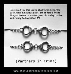 A fun highschool graduation gift for you and your best friend! A Set of two Rhodium plated Handcuffs bracelets   on a card that reads: To remind you that you'e stuck with me for life and to remind me how lucky I am to have a friend like you. Here's to another year of causing trouble and raising hell together!