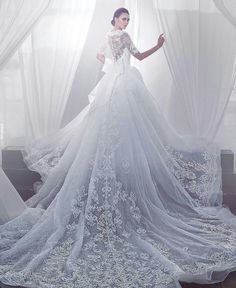 10 Wedding Gowns With The Longest Trains