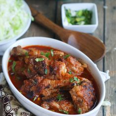 African Chicken Stew Recipe Soups, Main Dishes with oil, chicken, roma tomatoes, onions, minced garlic, dried thyme, paprika, curry powder, bay leaf, Maggi, green onions, parsley, sliced carrots, salt, pepper