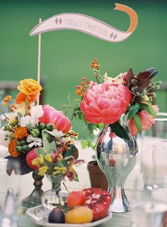 centerpieces with peonies, figs, pomegranates, ranunculus, persimmons...