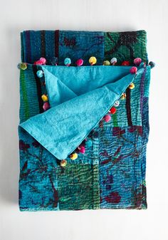 Tuck and Cover Blanket. Seek a tranquil sanctuary from the pressures of the outside world beneath this velvety Karma Living blanket. #blue #modcloth