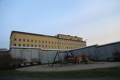 "Norway's largest prison, ""Oslo Fengsel"" is located more or less in the the heart of Oslo. Its capacity according to Wikipedia is 350 inmates and is skirted by this children's play ground."