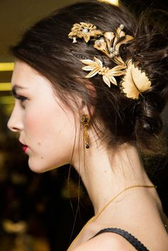 Vintage brooches as hair jewels. Dolce & Gabbana Fall 2015 Ready-to-Wear