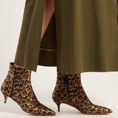 4efcce042fcb Aquazzura reinvents this its timeless Quant ankle boots in brown leopard  print