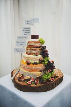 wedding cakes alternatives I like this non-traditional wedding cake.elegant stack of cheeses (plus a handmade pork pie). Obviously minus the pork pie for me. Traditional Wedding Cake, Traditional Cakes, Cheese Tower, Buffet Dessert, Dessert Food, Dessert Ideas, Alternative Wedding Cakes, Wedding Cake Alternatives, Wheel Cake