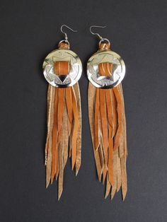 The Chica Bonita earrings. These earrings are from brown deerskin leather . The…