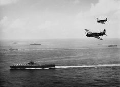 US Navy TG 38.3 off Okinawa, May 1945. US Navy Curtiss SB2C-4 Helldiver dive bombers from carrier USS Essex. Background: battleship USS Washington, an Essex-class carrier, and an Independence-class light carrier (US Navy photo 1996.253.360)
