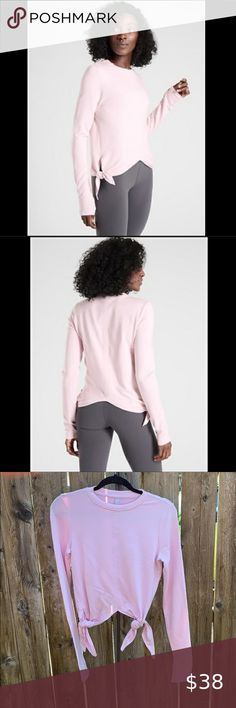 """Athleta Nirvana side tie Samsara sweatshirt Excellent condition size xxs Athleta Nirvana side tie Samsara pullover sweatshirt in pale pink. No rips or stains.measures approximately: 16"""" pit to pit across the chest, 16"""" long. Feel free to ask any questions. Athleta Tops Sweatshirts & Hoodies Room Rugs, Nirvana, Hoodies, Sweatshirts, Pale Pink, Ballet Skirt, Stains, Pullover, Tie"""