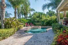 1369 Monterey Cir NE, St. Petersburg, FL - FOR SALE - Pavered Pool Deck, Lush Mature Landscape Provides Great Privacy to the Pebble Tec Pool and Heated Spa