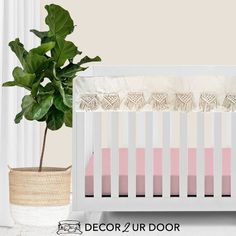 The boho nursery you've been dreaming of. Our Natural and Blush Pink Macrame Baby Bedding set is a Decor 2 Ur Decor EXCLUSIVE. We adore the texture of the macrame featured on the rail cover and crib skirt. We're in boho baby bedding heaven.