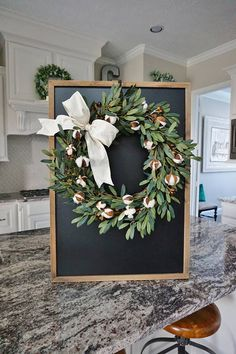 Featuring a Farmhouse inspired wreath arrangement decorated with mini olive leaf bush, clusters of soft cotton buds & cream colored cotton ribbon. ***Wreath shown is a 20-inch wreath. ❤ All wreaths are handcrafted by me using natural grapevine wreaths & only the highest quality faux