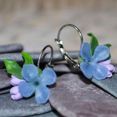 Welcome to Musa Natura, a place where you will find lots of handmade pieces inspired by Nature. Each one lovingly crafted by hand and made to order.  This listing is for a beautiful pair of lever back Lilac Earrings.  The Lilacs and Leaves have been hand sculpted from Polymer Clay, the leaves individually painted by hand and set on to the Silver tone earrings.  Each earring measures approximately 1 inch (2 1/2 cm) in length, from the hoop at the top of the earring to the tip of the petal...