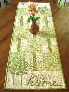This runner is perfect for your own table or even as a special housewarming gift. Customize it by using your favorite colors and patterns, or make it more neutral to go with any decor. Easy applique with a bit of embroidery -- as well as no curved pi...