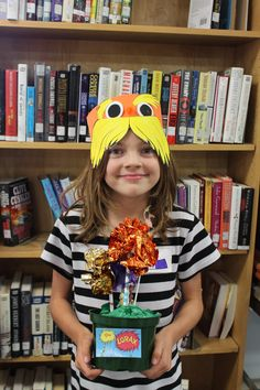 Ages 6-8. Their Lorax Hat and Truffula Tree Forest.