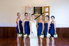 Navy blue bridesmaid dresses--perfect for a nautical wedding (Photo by Lizzy C Photography)