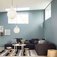 Plenty of seating in this modern minimalist living room. The large pendant lights help fill out the space created by the high ceilings. Nordic Living, Home And Living, Jotun Lady, Living Room Decor, Living Spaces, Blue Bedroom, Home Decor Inspiration, House Colors, Colorful Interiors