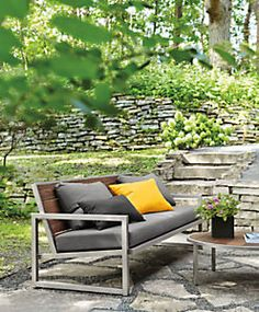 The Montego outdoor sofa features a striking mix of solid ipe wood and hand-welded stainless steel or powder-coated stainless steel, making it as durable as it is eye-catching. Left untreated, ipe develops a beautiful silver patina. Perfect for lounging, this modern sofa also includes weather-resistant cushions in an array of color options.