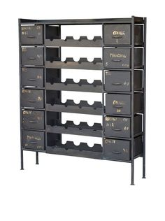 "CDI Furniture Industrial Iron Wine Bottle Chest, Grey Store your collection of wines on the shelves and accessories in the drawers of this shabby chic design Country of origin: India Material type: Iron Package Dimensions: length 59"", height 13.2"", width 49"" Item Dimensions: height 59"", width 48"", depth 13"""