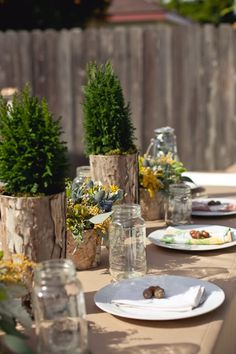 "Love the rustic outdoor theme.  White plates, mason jar ""glasses"", and burlap tablecloth would be a great start for many different themes."